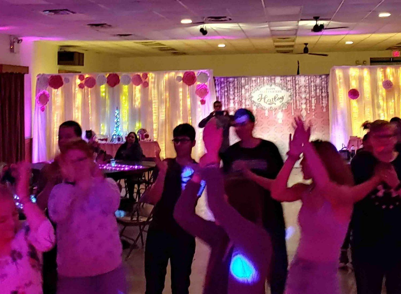 Kids Dancing on Dance Floor at Sweet 16 Party.