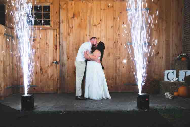 Bride & Groom Kissing with Cold Sparklers to their sides