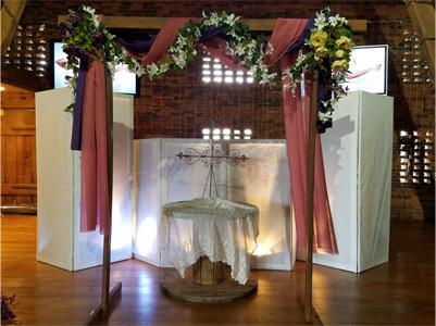 DJ Booth with DJ Screens behind Wooden Arch in Barn