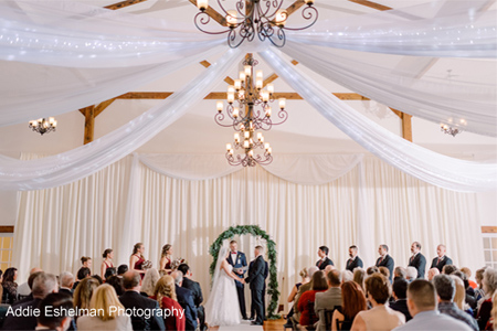 White Ceiling Wedding drapery with String lights, Pipe and Drape with Tule Accents