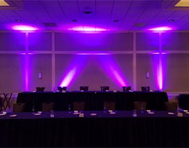 Purple Uplighting behind head table.
