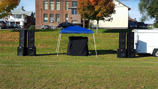 DJ Booth under ez up blue tent for Race 4 Education